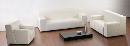 A modern minimalist living-room with white furniture Stock Photo - 4518915