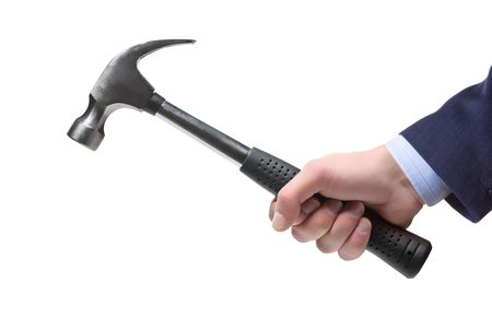 A businessman�s hand holding a hammer isolated on a white background photo