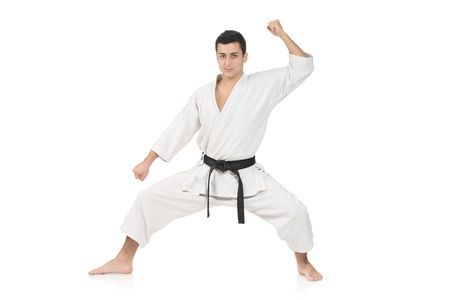 A karate man isolated against white background photo