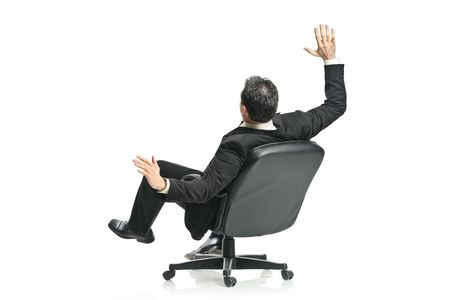 threatened: A young businessman in a chair isolated on a white background Stock Photo