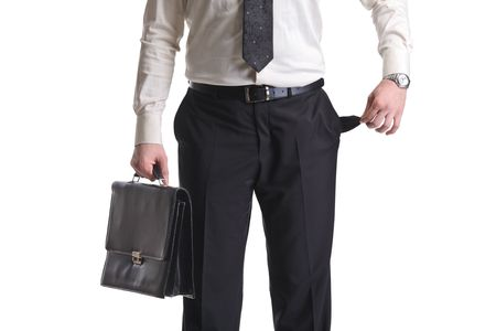 moneyless: A businessman showing an empty pocket isolated on a white background