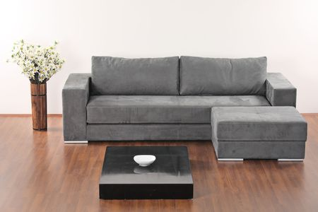 A modern minimalist living-room with grey furniture photo