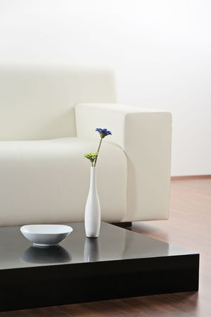 A vase and flower at table in modern  living-room Stock Photo - 4817854