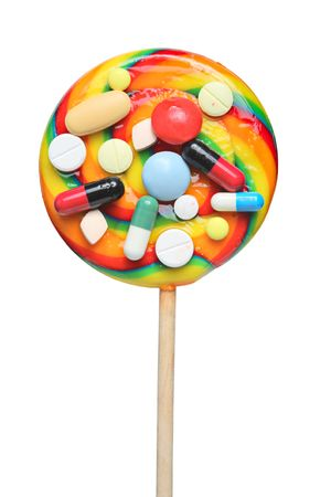 Pills stuck on a lollipop isolated on a chite background photo