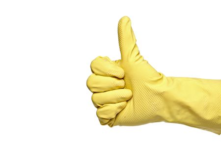 Thumbs-up with a yellow rubber glove isolated on a white background photo