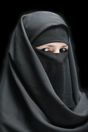 A veiled woman isolated on a black background photo