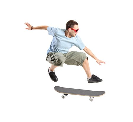 A skateboarder jumping isolated on a white background photo