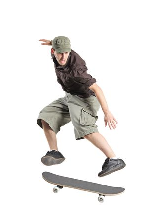 board shorts: A skateboarder jumping isolated on a white background Stock Photo