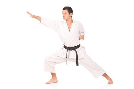 Karate man isolated against white background photo