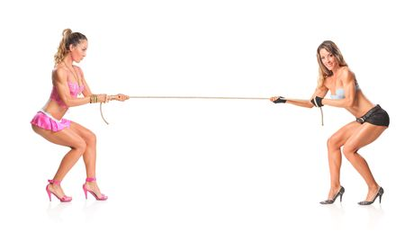 Beautiful girls pulling a rope isolated on white background photo