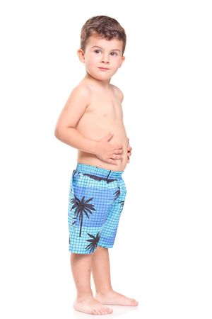 Adorable young boy posing isolated on white background Stock Photo - 5508190