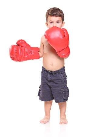 Kid with red boxing gloves isolated on white background Stock Photo - 5508192