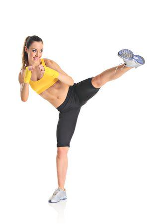 Beautiful girl kicking with the leg isolated on white background Stock Photo - 5559820