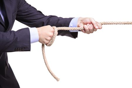 Businessman pulling a rope isolated on white background Stock Photo - 5554411