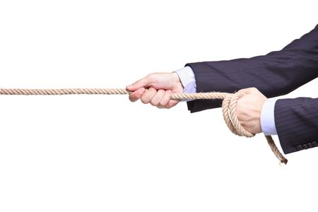 Businessman pulling a rope isolated on white background photo