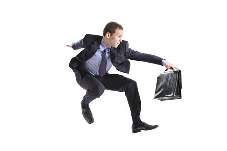 Young businessman with a briefcase jumping against white background photo