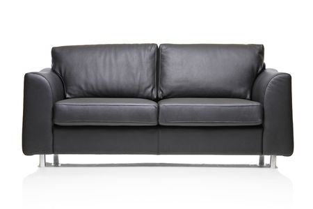 modern sofa: Image of a modern black leather sofa over white background Stock Photo