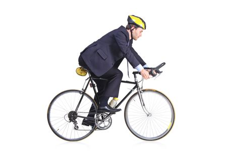 helmet bike: Businessman in a suit riding a bicycle