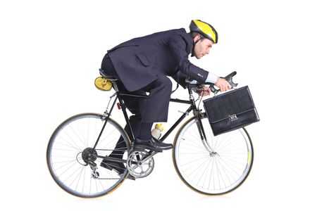 Businessman in a suit with a briefcase riding a bicycle  photo