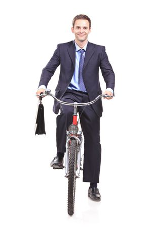 Young businessman on a bicycle isolated white background photo