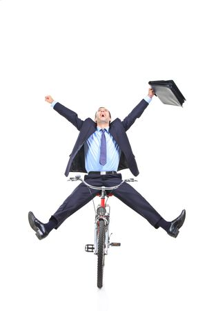 Happy young businessman on a bicycle photo