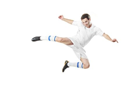 Soccer player in a jump isolated on white background Stock Photo - 5886376