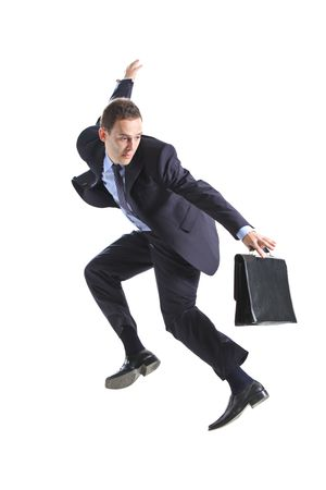 Young businessman with a briefcase jumping against white background Stock Photo - 5798308