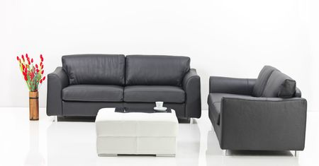 A modern minimalist living-room with white furniture photo