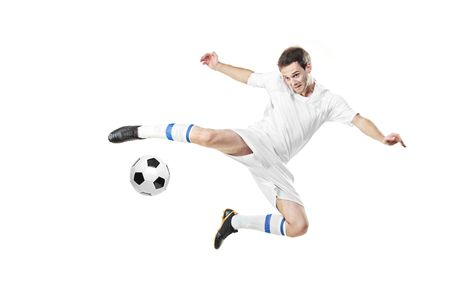 tricot: Soccer player with a ball in action isolated on white background
