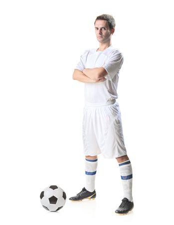 plimsoll: Football player with a soccer ball isolated against white background