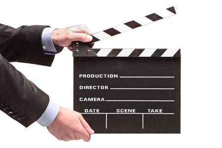 Person with a movie clap isolated against white background photo