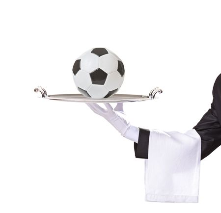 Waiter holding a silver tray with a football on it isolated on white background Stock Photo - 5916710