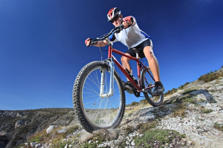 Person riding a bike downhill style photo