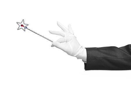 Holding a magic wand isolated on white background photo