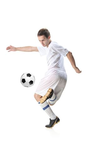 tricot: Football player with ball isolated against white background