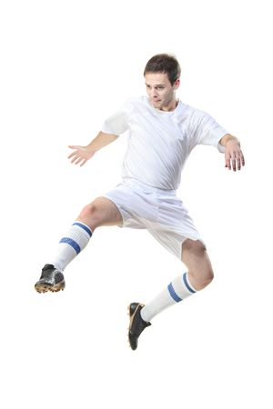 plimsoll: Football player in jump isolated against white background Stock Photo