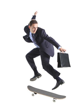 skateboarding: A businessman with skateboard jumping isolated on a white background Stock Photo