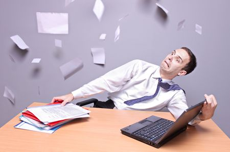 Shocked  businessman Flying documents in the office  Stock Photo - 5945239