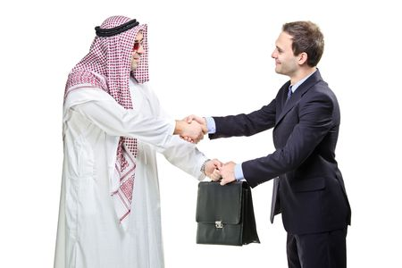 Arab person shaking hands with a businessman isolated on white photo