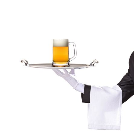 Waiter holding a silver tray with a beer mug on it photo