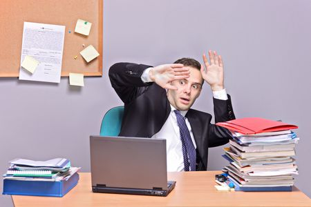 Frightened businessman in an office photo