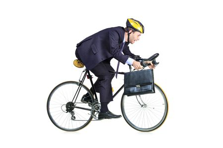 riding: Businessman in a suit with a briefcase riding a bicycle