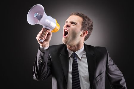 announcing: Angry businessman announcing via loudspeaker