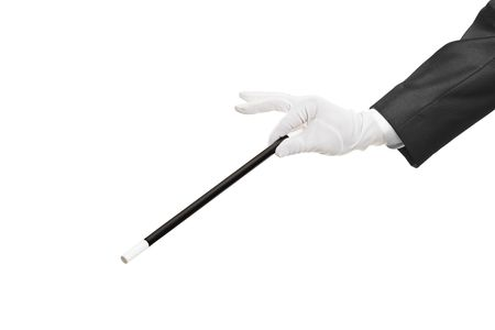 Hand holding a magic wand isolated on white background photo