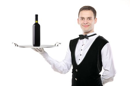 Battler holding a silver tray with wine bottle on it  photo