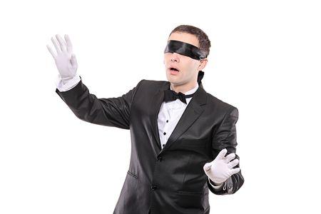 Blindfold elegant man isolated on white background Stock Photo - 6105731