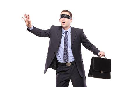 Confused blindfold businessman with briefcase isolated on white Stock Photo - 6105730