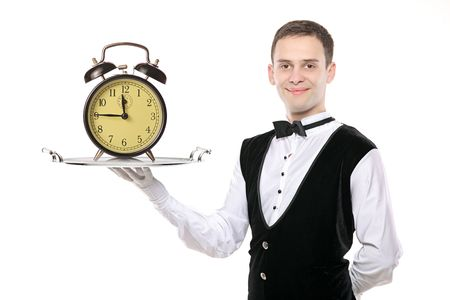 trencher: Buttler holding a silver tray with a alarm clock on it