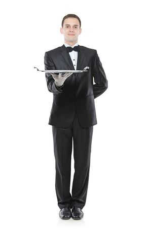 silver tray: A buttler holding a tray isolated agasinst white background