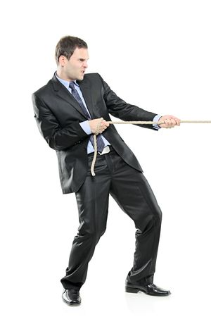 A young businessman pulling a rope isolated on white background Stock Photo - 6128806